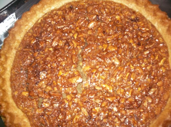 Pour into crust and bake until set and brown (approximately 30 minutes).