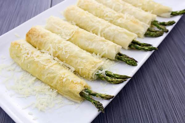 Crispy Garlic Parmesan Asparagus Pillows On A White Plate.