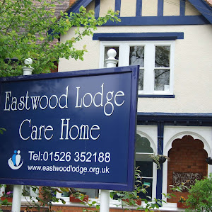 the eastwood lodge road sign at the entrance to eastwood lodge