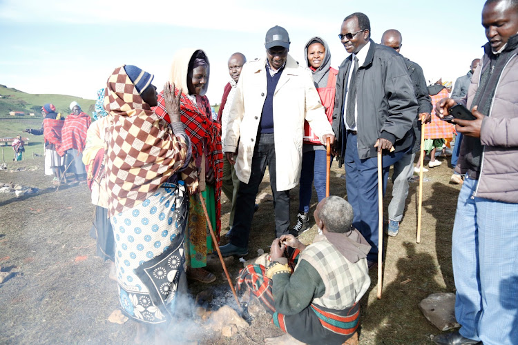 Deputy President William Ruto talks to some of the families affected by the land slides on Monday.