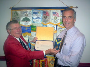 Photo: President Frank and President-Elect Joe Johnson - Joe is proud to show us his Paul Harris Certificate, Pin, and Medallion