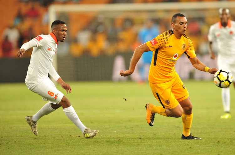 Ryan Moon of Kaizer Chiefs challenged by Lorence Vilakazi of Polokwane City during Absa Premiership 2017/18 game between Kaizer Chuefs and Polokwane City at FNB Stadium in Johannesburg South Africa on 13 January 2018.