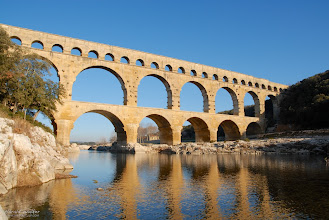 Photo: The arches of the Pont Du Gard in the low winter sun.