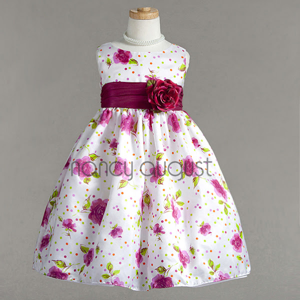 Photo: Sassy Flower Print Girls Dress: This fuchsia flowered girl dress is a refreshing print just in time for the Spring! This casual dress features a fun flower print with cute colorful dots. The poly cotton blend fabric pairs brilliantly with a beautiful contrasting waist sash accented with a detachable flower. This girls dress is conveniently available in baby, toddler and matching girl sizes.