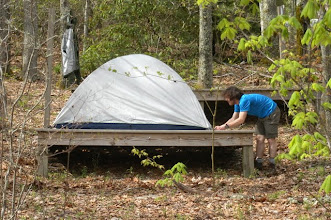 Photo: Paulo setting up his tent on a tent platform