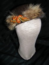 Photo: <KAPELUXE> Unique-Chique Hats by Luba Bilash ART & ADORNMENT  Chocolate brown wool felt; raccoon; leather twist 360 degree possibilities. Can also be worn on an angle. Size S - 52 cm/20.5 in $70