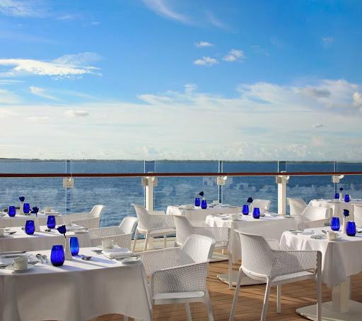 Enjoy al fresco dining on the terrace of Blu restaurant on Celebrity Apex.