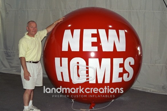 Photo: When it comes to dominating the real estate industry inflatable helium spheres, like this 7-foot red ball, bring attention to new listings and help gain attention.