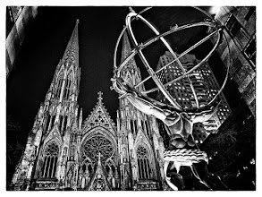 Photo: I've been combing through some older shots that I took in New York looking for ideas on what to shoot when I visit there this week. I took this shot of Atlas and St. Patrick's Cathedral about 4 years ago. I've always liked the juxtaposition of Atlas and St. Patrick's, but I've never been fond of the other buildings in the shot. I've played around with this image several times and this morning I decided to try a high contrast black and white. I used one of the Film Noir presets of Silver Efex Pro 2 and then made some further adjustments.  Olympus E-3 14-54mm @ 14mm (2x crop factor) 1/2 sec at f/3.2
