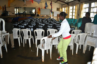 Photo: Tirzah helping to organize the chairs.