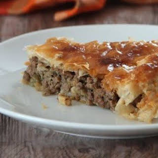Puff pie with meat and eggplant Balkan-style.