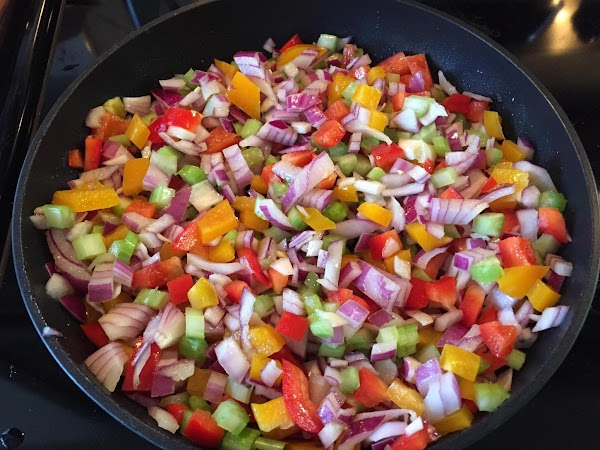 In a frying pan, over medium heat, lightly stir-fry red onion, celery, and peppers...