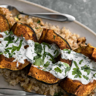 Harissa Acorn Squash with Bulgur and Yogurt Sauce.