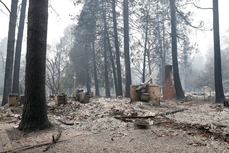 A house destroyed by the Camp Fire is seen in Paradise, California, the US, on November 13 2018. Picture: REUTERS/TERRAY SYLVESTER