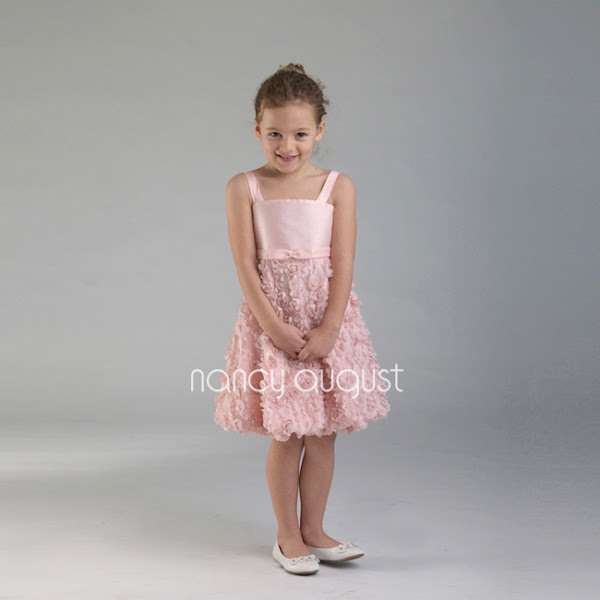 Photo: #California #Sweetheart Pink #Poppy #Ruffle Dress: Don't you just love the delicate detail of this Sweetheart Pink Poppy Ruffle Dress? Featuring a fine poly #dupioni #halter bodice, this gorgeous dress for little girls is one of a kind. The double straps on the bodice make it simple for your little one to get in and out of this adorable dress! You can be sure that every mom out there would love to get her hands on this #stunning piece.