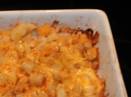 Sprinkle cheese and the other 1/2  of potato chips over the top. Return to oven...