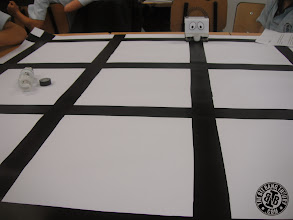 Photo: White Infante Robot in navigation grid