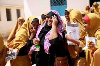 Photo: Amazing what girl-friendly spaces (rooms for private toilets, room for prayer, and changing room in secondary schools) can do to increase the attendance and performance of girls in school. Somali girls are generally very shy and in the Somali culture it is a shame to be seen going into or coming out of toilets. Fort his reason female students dont use the school latrines or they go home and sometimes never come back. GFS are changing these realities. In the Pic is me after going for a monitoring visit to a GFS in Garowe. These girls were so happy with their GFS in their school.