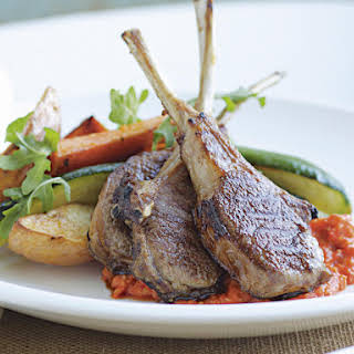 Lamb Chops with Red Pepper Sauce and Roasted Vegetables.