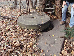 Photo: Millstone covering a well on the property. December, 2011.