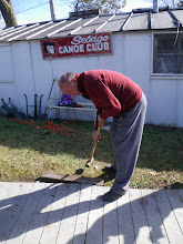 Photo: Commodore Emeritus Tony works on his croquet stroke. No, really, the sledgehammer and a couple of crowbars were used to set the pieces perfectly in place.