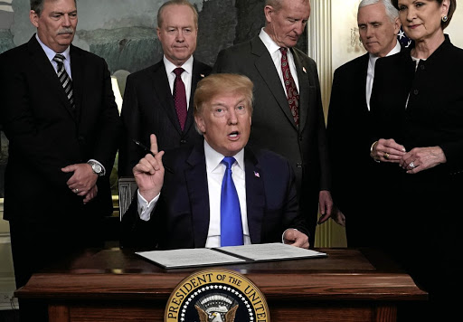 Pressing on: US President Donald Trump, prepares to sign a memorandum on intellectual property tariffs on goods from China on March 22. Picture: REUTERS