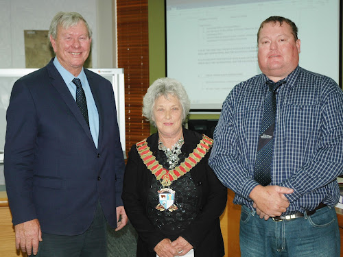 Outgoing Mayor Conrad Bolton with his successor Cathy Redding and new Deputy Mayor Cameron Staines.