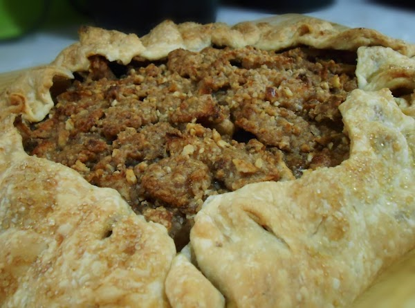 Place apple crumb mixture in center and fold edges up around the sides. ...