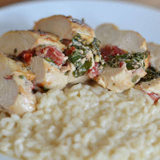 Spinach and Roasted Red Pepper Stuffed Chicken Breast with Parmesan Risotto.