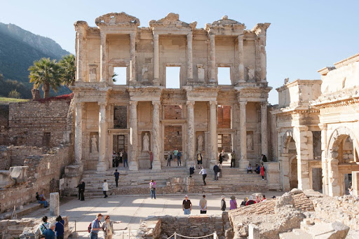 Enjoy a five-course, white glove candlelit dinner accompanied by a chamber trio at the Library of Celsus in Ephesus, Turkey, on a Windstar cruise.