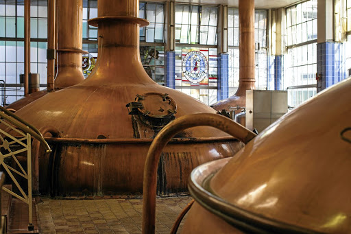 Monolith: Copper brewing vats stand inside the Beck's Brewery, operated by AB InBev, in Bremen, Germany. Picture: Bloomberg/Jasper Juinen