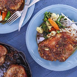 Orange-Glazed Pork Chops, Roasted Vegetable Medley and Almond Rice Pilaf.