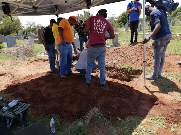 Members of the missing persons task team exhume the body of the last of the Mamelodi 10 in Winterveld cemetery on Thursday.
