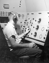 Photo: H.F. Carey, TDAN, operates a radio navigational panel in the new flight trainer and space simulator