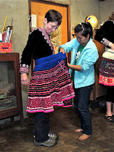Photo: Melanie being dressed as a Hmong