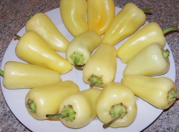 Wash your peppers and dry them off and put them on a plate to...