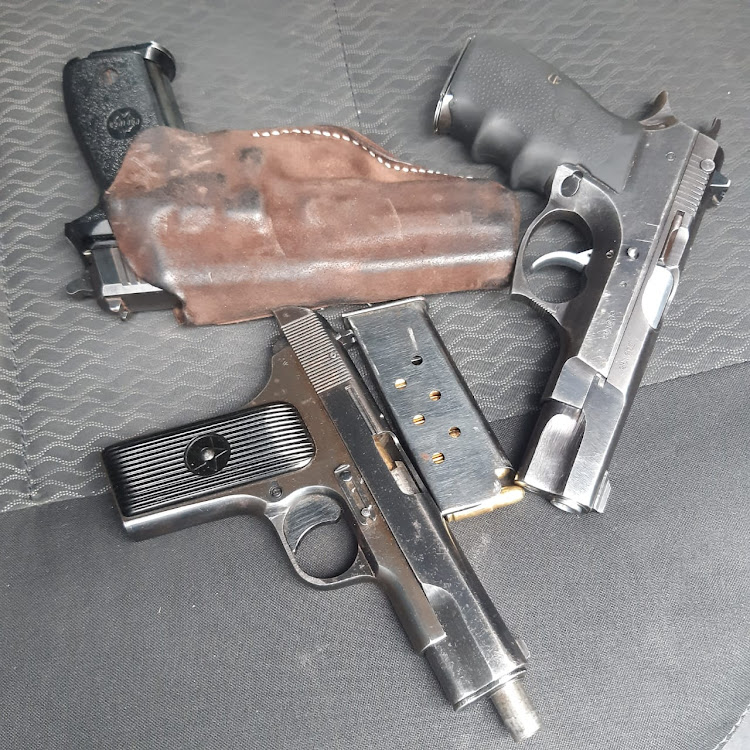 Three firearms were confiscated from the suspects after they allegedly assaulted a motorist.