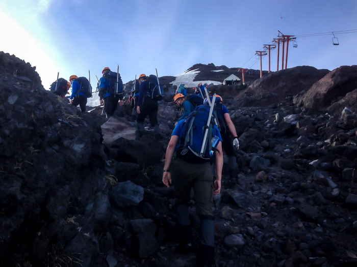 trekking through the rocks on the Villarrica volcano hike in pucon chile