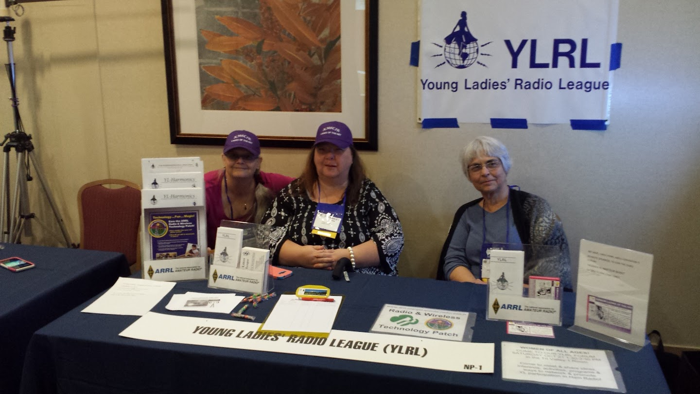 Janet Fisher KK6RXO, Tina Madsen KK6KSY, and Emilia Seiferling KI6YYT at the YLRL Booth