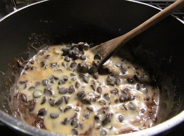 in a medium saucepan, add your salt, simi sweet chocolate chips and condensed milk.  Heat...