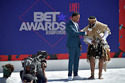 Terrence J (left) presents Sjava with the Viewers' Choice: Best International Act Award at the 2018 BET Awards.