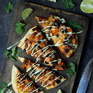 Chipotle Chicken Sweet Potato and Black Bean Flatbread Pizzas with Avocado Sour Cream.