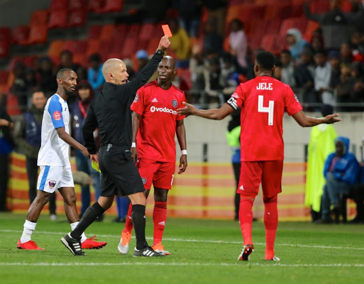 Referee Victor Gomez shows a red card to Orlando Pirates defender Mthokozisi Dube during the Absa Premiership match against Chippa United at Nelson Mandela Bay Stadium on August 08, 2018 in Port Elizabeth, South Africa. Pirates won 1-0.
