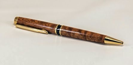 "Photo: Gary Guenther 5 1/2"" x 1/2"" pen [pommel sapele, Hart twist]"