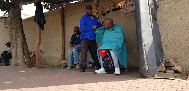 Ntshebe's barber in Orlando East.