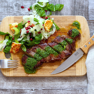 Sizzling New York Steak with Chimichurri Sauce.