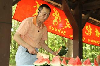 Photo: Board chairman Lianggen preparing wottermellon.