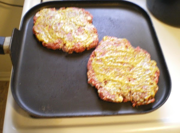 Place burgers on skillet or grill mustard side up until browned.  Flip and...