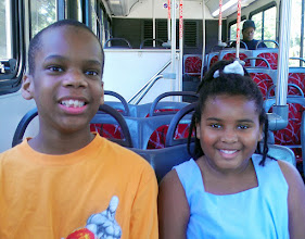 Photo: On the bus to go the park. It was Kaleya's first time riding a city bus. It was like an adventure to her. :-)