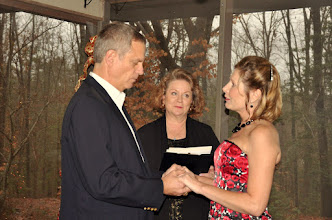 Photo: Elopement at their home.  Wedding Ceremony in progress.  http://WeddingWoman.net